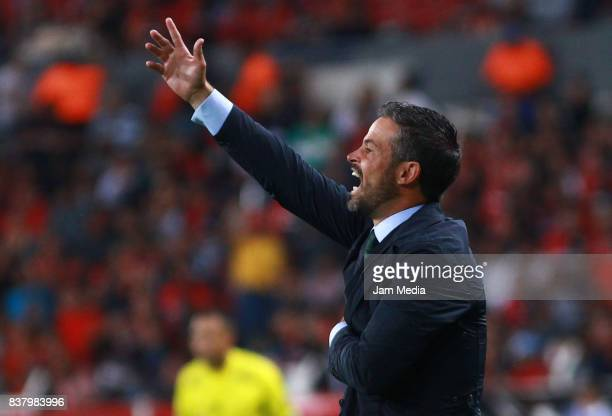 Rafael Puente Coach of Lobos BUAP gives instructions to his players during the 6th round match between Atlas and Lobos BUAP as part of the Torneo...