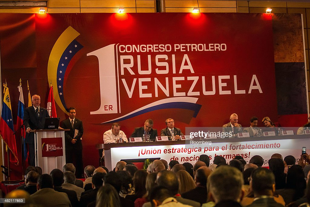 Rafael Ramirez, Venezuela's oil minister and president of the state-owned oil company Petroleos de Venezuela SA (PDVSA), speaks at the first Russia-Venezuela Oil Congress on Margarita Island in Nueva Esparta, Venezuela, on Thursday, Nov. 21, 2013. OAO Rosneft, Russia's largest oil producer, plans to invest $13 billion in five projects in Venezuela over five years and buy at least part of OAO Lukoil's stake in a producing field in the South American nation. Photographer: Meridith Kohut/Bloomberg via Getty Images
