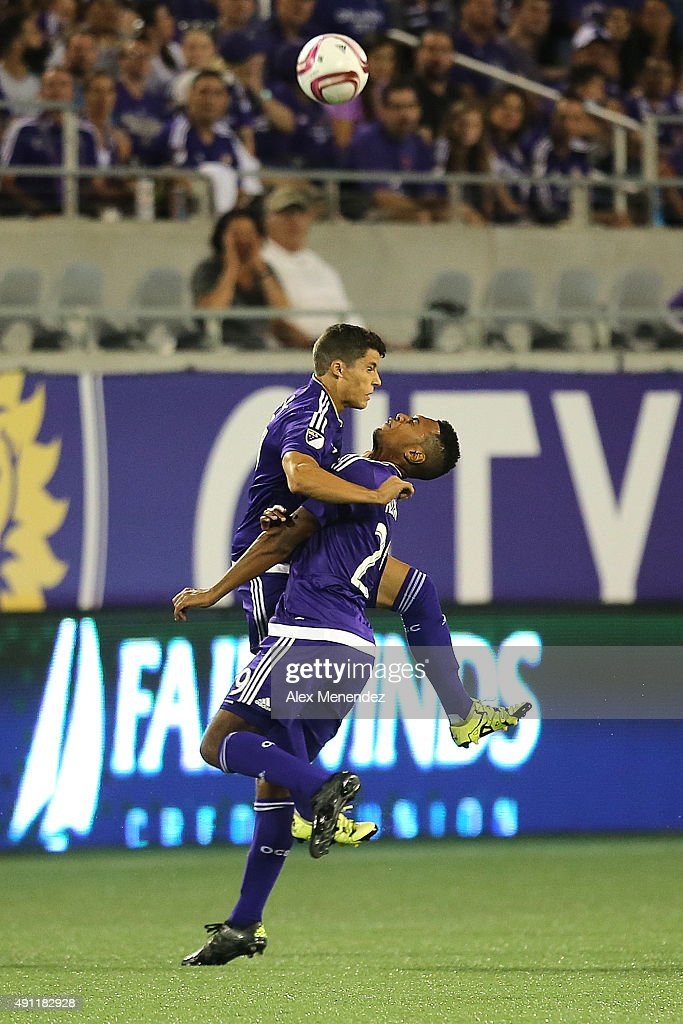Rafael Ramos #27 of Orlando City SC (L) and Tommy Redding #29 of Orlando City SC collide after going for the ball during an MLS soccer match between the Montreal Impact and the Orlando City SC at the Orlando Citrus Bowl on October 3, 2015 in Orlando, Florida. Both players were taken off the field by medical personnel.
