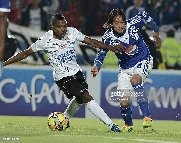Rafael Robayo of Millonarios struggles for the ball with Jose Izquierdo of Once Caldas during a match between Millonarios and Once Caldas as part of...