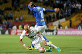 Rafael Robayo of Millonarios vies for the ball with Elkin Soto of Once Caldas during a match between Millonarios and Once Caldas as part of round 11...