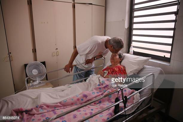 Rafael RoblesOrtiz kisses his mother Josefina Ortiz who is staying at the Hermanitas de los Ancianos Desamparados facility which cares for the...