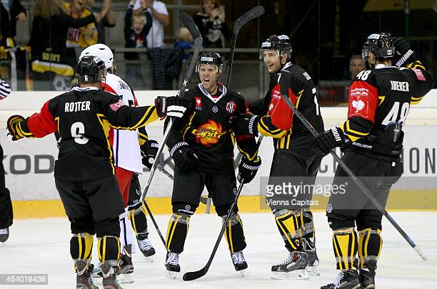 Rafael Rotter Peter MacArthur Brett Carson and Florian Iberer of Capitals celebrate during the Champions Hockey League group stage game between EV...