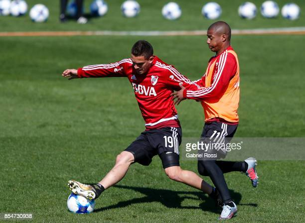 Rafael Santos Borre of River Plate fights for the ball with teammate Nicolas De la Cruz during a training session at River Plate's training camp on...