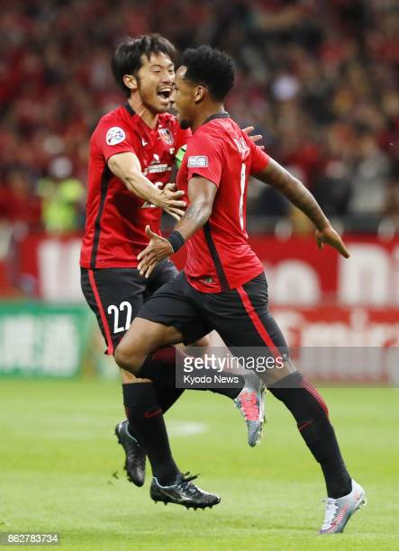 Rafael Silva celebrates with Urawa Reds teammate Yuki Abe after scoring during the first half in the second leg of their Asian Champions League...