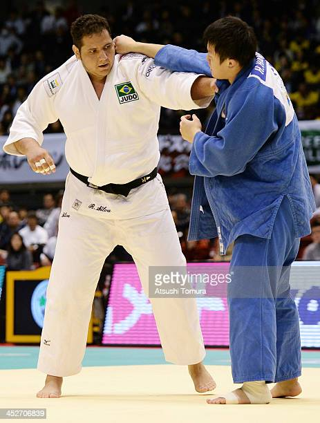 Rafael Silva of Brazil and Hisayoshi Harasawa of Japan compete in the men's 100kg quaterfinal match during day three of the Judo Grand Slam at the on...