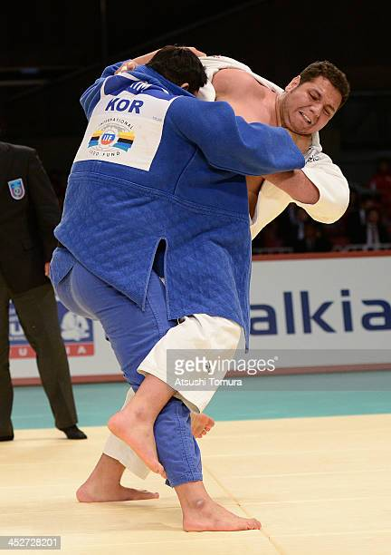 Rafael Silva of Brazil and SungMin Kim of Korea compete in the men's 100kg final match during day three of the Judo Grand Slam at the on December 1...
