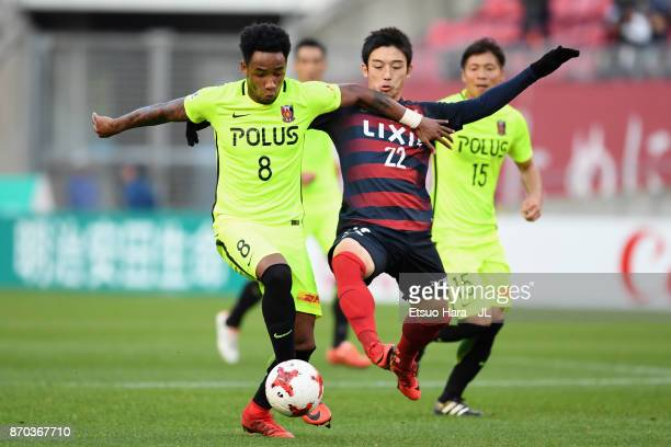 Rafael Silva of Urawa Red Diamonds and Daigo Nishi of Kashima Antlers compete for the ball during the JLeague J1 match between Kashima Antlers and...