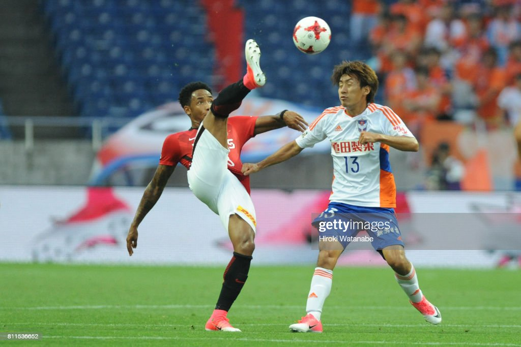 Rafael Silva #8 of Urawa Red Diamonds and Masaru Kato #13 of Albirex Niigata compete for the ball during the J.League J1 match between Urawa Red Diamonds and Albirex Niigata at Saitama Stadium on July 9, 2017 in Saitama, Japan.