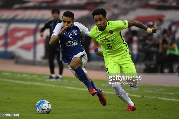 Rafael Silva of Urawa Red Diamonds and Mohammed AlBurayk of AlHilal compete for the ball during the AFC Champions League Final 2017 first leg between...