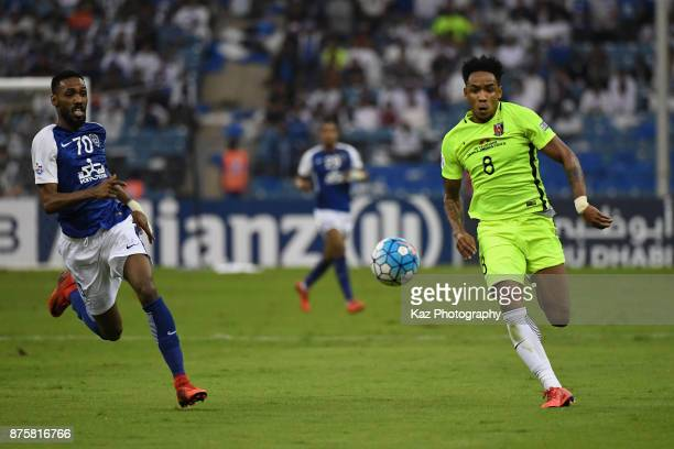 Rafael Silva of Urawa Red Diamonds and Mohammed Jahfali of AlHilal compete for the ball during the AFC Champions League Final 2017 first leg between...