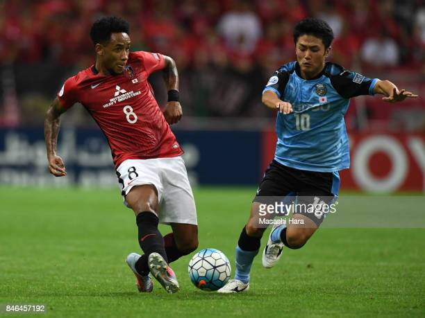 Rafael Silva of Urawa Red Diamonds and Ryota Oshima of Kawasaki Frontale compete for the ball during the AFC Champions League quarter final second...