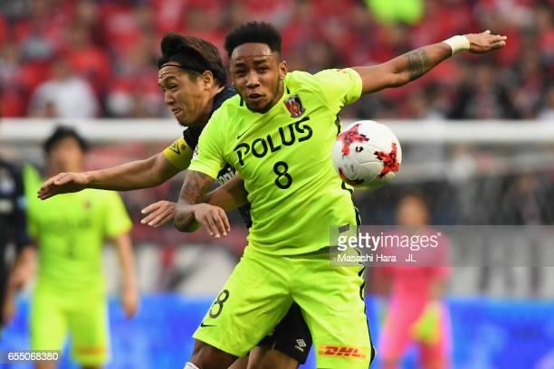 Rafael Silva of Urawa Red Diamonds and Yasuhito Endo of Gamba Osaka compete for the ball during the JLeague J1 match between Gamba Osaka and Urawa...