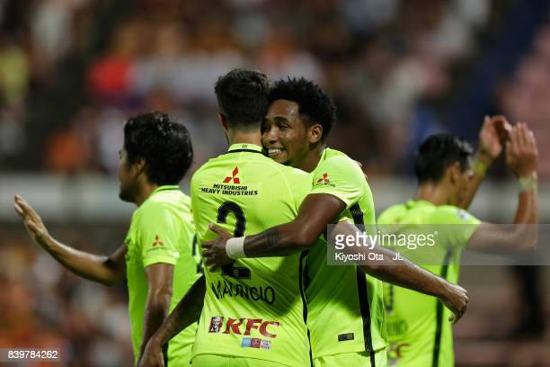 Rafael Silva of Urawa Red Diamonds celebrates scoring his side's second goal with his team mate Mauricio during the JLeague J1 match between Shimizu...