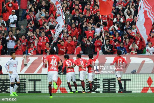 Rafael Silva of Urawa Red Diamonds celebrates scoring his side's third goal with his team mates during the JLeague J1 match between Urawa Red...