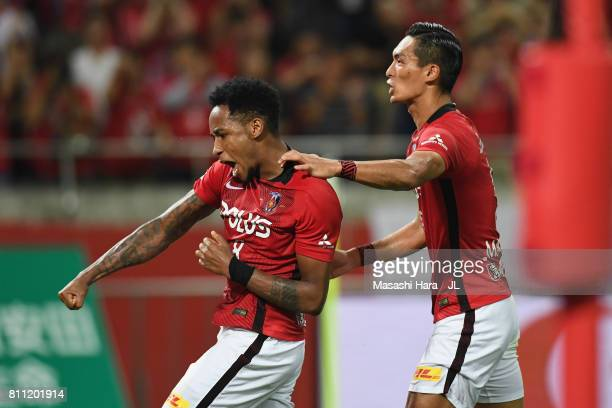 Rafael Silva of Urawa Red Diamonds celebrates scoring his team's second goal with his team mate Tomoaki Makino during the JLeague J1 match between...