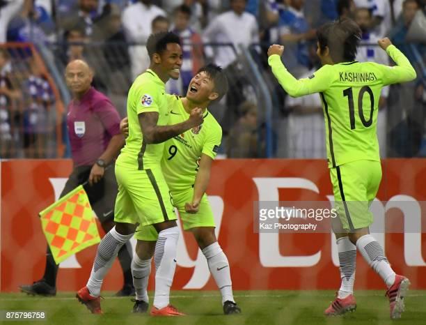 Rafael Silva of Urawa Red Diamonds celebrates scoring the opening goal with his team mates Yuki Muto and Yoshike Kashiwagi during the AFC Champions...
