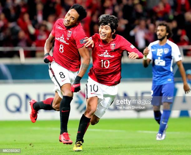 Rafael Silva of Urawa Red Diamonds celebrates scoring the opening goal with his team mate Yosuke Kashiwagi during the AFC Champions League Final...