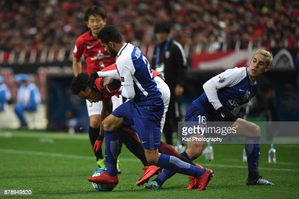 Rafael Silva of Urawa Red Diamonds competes for the ball against Mohammed AlBurayk and Nicolas Milesi of AlHilal during the AFC Champions League...