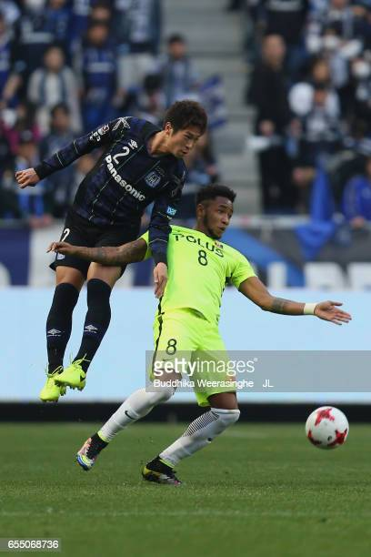 Rafael Silva of Urawa Red Diamonds controls the ball under pressure of Genta Miura of Gamba Osaka during the JLeague J1 match between Gamba Osaka and...