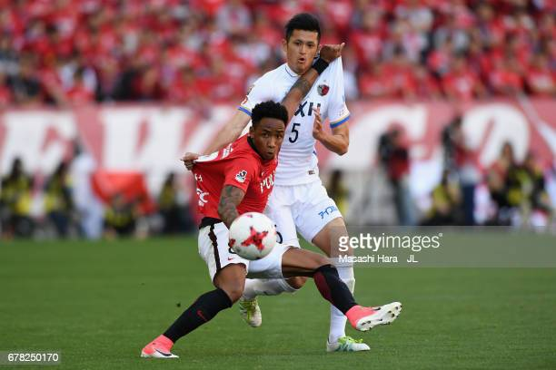 Rafael Silva of Urawa Red Diamonds controls the ball under pressure of Naomichi Ueda of Kashima Antlers during the JLeague J1 match between Urawa Red...