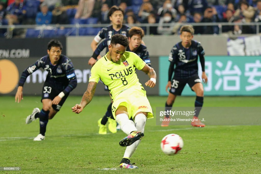 Rafael Silva of Urawa Red Diamonds converts the penalty to score his side's first goal during the J.League J1 match between Gamba Osaka and Urawa Red Diamonds at Suita City Football Stadium on March 19, 2017 in Suita, Osaka, Japan.