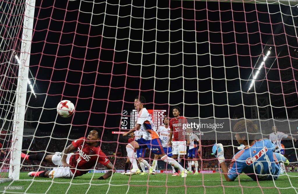 Rafael Silva (1st L) of Urawa Red Diamonds scores his side's second goal during the J.League J1 match between Urawa Red Diamonds and Albirex Niigata at Saitama Stadium on July 9, 2017 in Saitama, Japan.