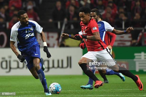 Rafael Silva of Urawa Red Diamonds takes on Mohammed Jahfali of AlHilal during the AFC Champions League Final second leg match between Urawa Red...