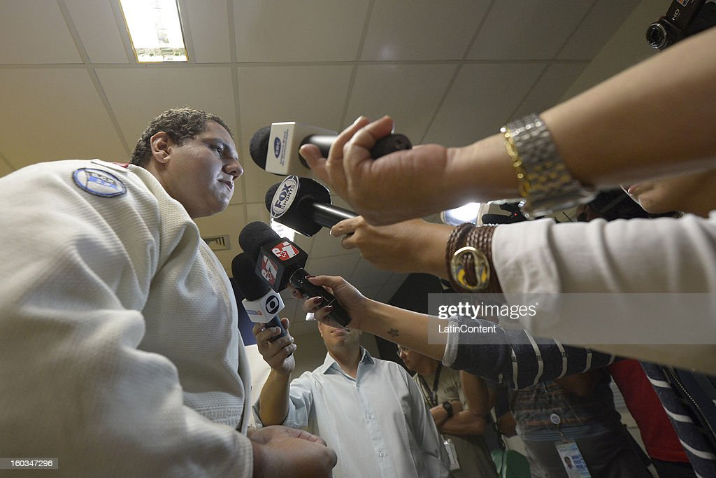 <a gi-track='captionPersonalityLinkClicked' href=/galleries/search?phrase=Rafael+Silva+-+Judoka&family=editorial&specificpeople=7115258 ng-click='$event.stopPropagation()'>Rafael Silva</a> talks to the press during the first official training season of the team, who will represent Brazil in the Olympic Games Rio 2016, at Maria Lenk Aquatic Center on January 29, 2013 in Rio de Janeiro, Brazil.
