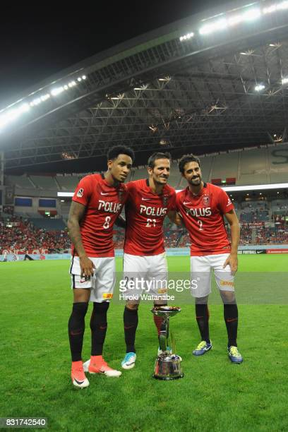 Rafael Silva Zlatan Ljubijankic and Mauricio of Urawa Red Diamonds celebrate after the Suruga Bank Championship match between Urawa Red Diamonds and...