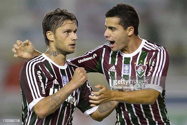 Rafael Sobis and Eduardo of Fluminense celebrates a scored goal during the match between Fluminense and Goias a as part of Brazilian Championship...