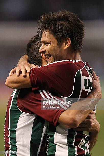 Rafael Sobis and Thiago Neves of Fluminense celebrate a scored goal during the final first leg match between Botafogo v Fluminense as part of Rio de...