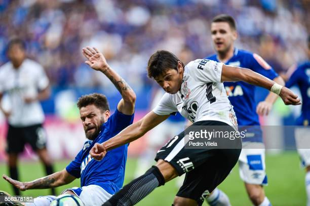 Rafael Sobis of Cruzeiro and Angel Romero of Corinthians battle for the ball during a match between Cruzeiro and Corinthians as part of Brasileirao...