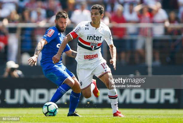 Rafael Sobis of Cruzeiro and Hernanes of Sao Paulo in action during the match between Sao Paulo and Cruzeiro for the Brasileirao Series A 2017 at...