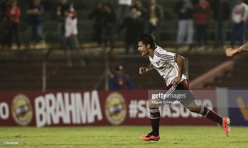 <a gi-track='captionPersonalityLinkClicked' href=/galleries/search?phrase=Rafael+Sobis&family=editorial&specificpeople=682143 ng-click='$event.stopPropagation()'>Rafael Sobis</a> of Fluminense celebrates a goal during a match between Portuguesa and Fluminense as part of the Brazilian Serie A 2013 at Caninde stadium on June 12, 2013 in Sao Paulo, Brazil