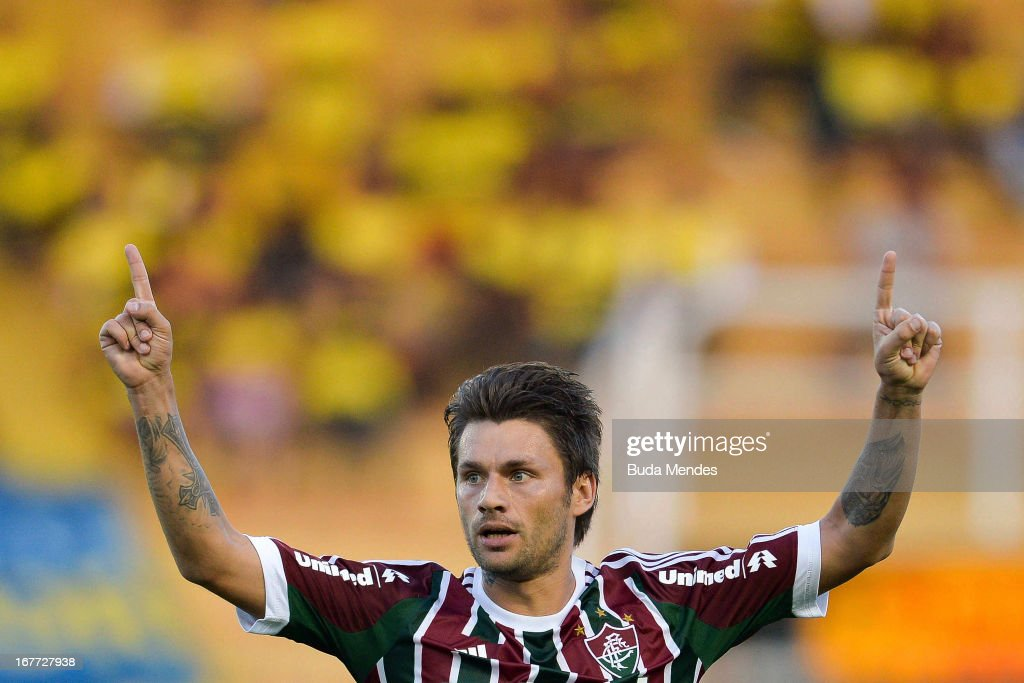 <a gi-track='captionPersonalityLinkClicked' href=/galleries/search?phrase=Rafael+Sobis&family=editorial&specificpeople=682143 ng-click='$event.stopPropagation()'>Rafael Sobis</a> of Fluminense celebrates a scored goal during the match between Fluminense and Volta Redonda as part of Rio State Championship 2013 at Raulino de Oliveira Stadium on April 28, 2013 in Volta Redonda, Brazil.