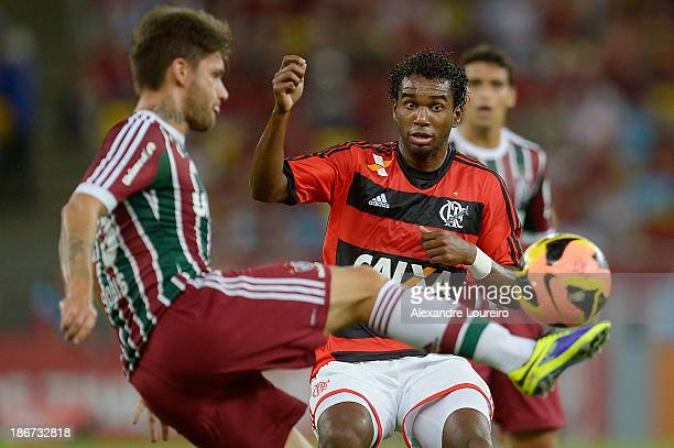 Rafael Sobis of Fluminense fights for the ball with Luis Antonio of Flamengo during the match between Flamengo and Fluminense for the Brazilian...