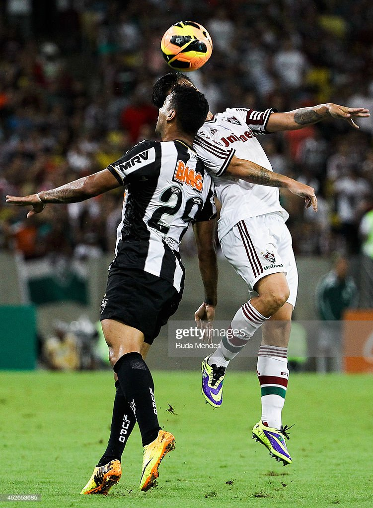Rafael Sobis of Fluminense fights for the ball with Michel of Atletico Mineiro during the match between Fluminense and Atletico Mineiro for the...