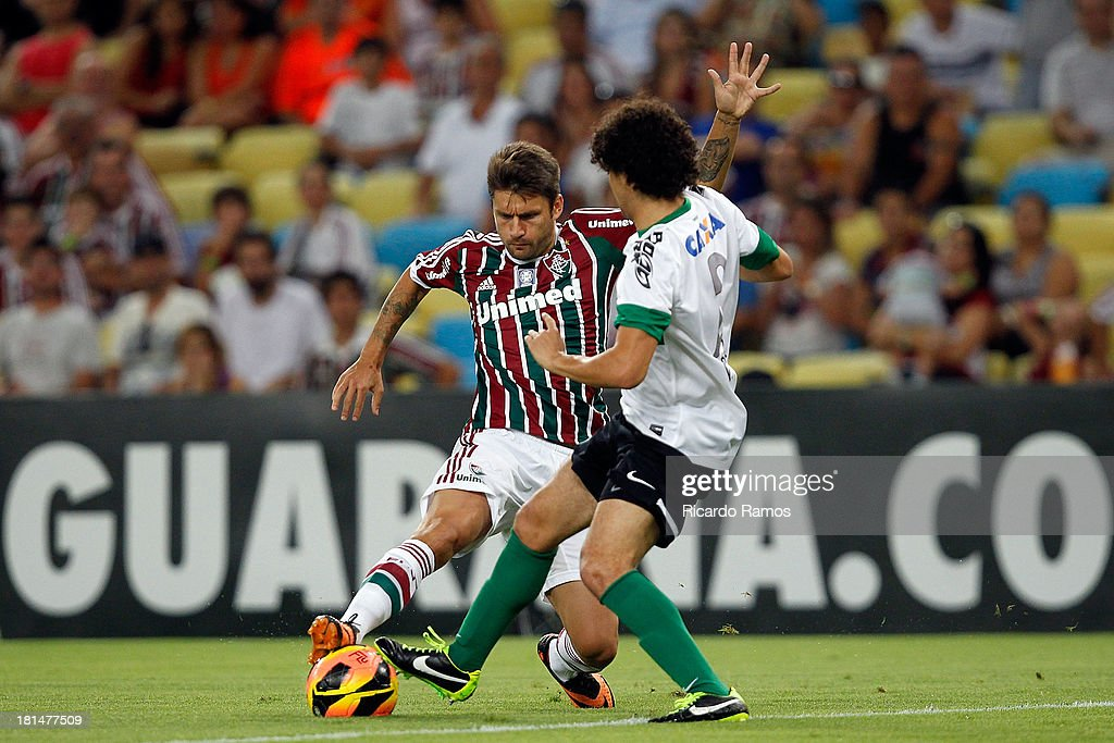 Rafael Sobis of Fluminense fights for the ball with Victor Ferraz of Coritiba during the match between Fluminense and Coritiba for the Brazilian Series A 2013 at Maracana on September 21, 2013 in Rio de Janeiro, Brazil.