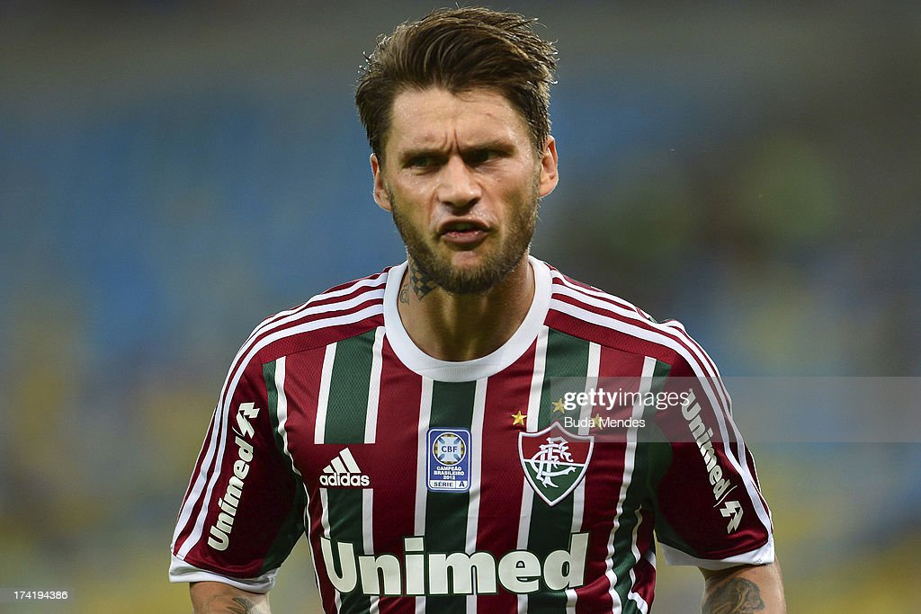 <a gi-track='captionPersonalityLinkClicked' href=/galleries/search?phrase=Rafael+Sobis&family=editorial&specificpeople=682143 ng-click='$event.stopPropagation()'>Rafael Sobis</a> of Fluminense gestures during a match between Fluminense and Vasco as part of Brazilian Championship 2013 at Maracana Stadium on July 21, 2013 in Rio de Janeiro, Brazil.