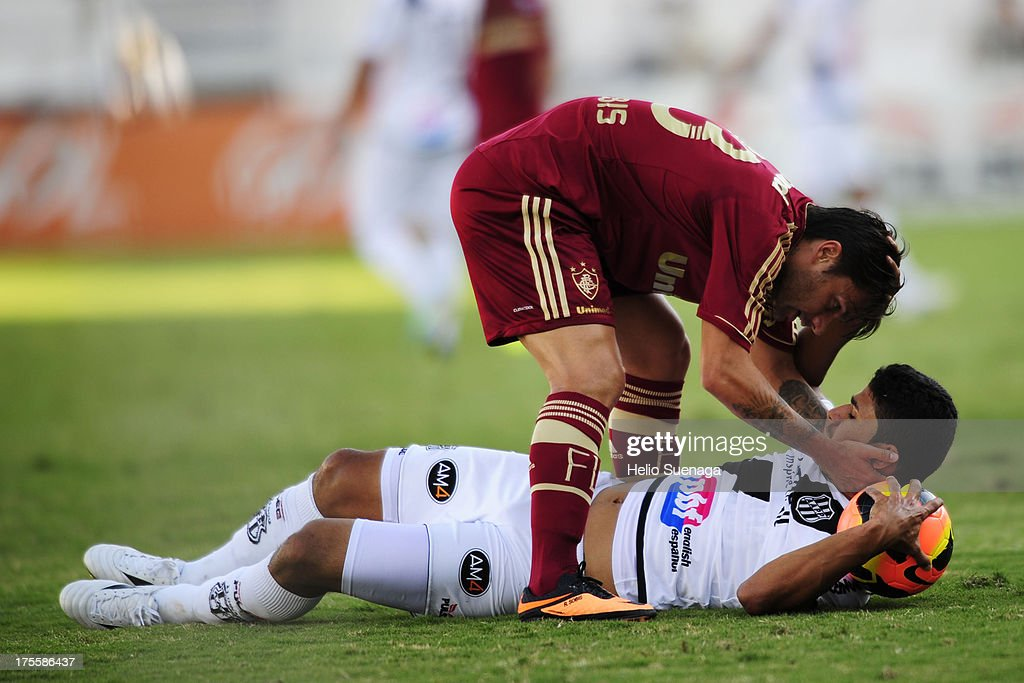 <a gi-track='captionPersonalityLinkClicked' href=/galleries/search?phrase=Rafael+Sobis&family=editorial&specificpeople=682143 ng-click='$event.stopPropagation()'>Rafael Sobis</a> of Fluminense helps a Ponte Preta player during a match between Fluminense and Ponte Preta as part of the Brazilian Championship Serie A 2013 at Moises Lucarelli Stadium on August 04, 2013 in Campinas, Brazil.