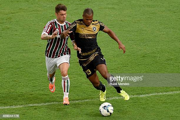 Rafael Sobis of Fluminense struggles for the ball with Andre Bahia of Botafogo during a match between Fluminense and Botofogo as part of Brasileirao...