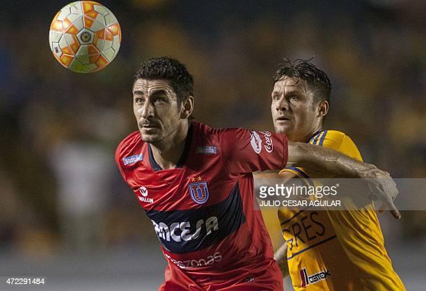 Rafael Sobis of Mexican Tigres and Ignacio Gonzalez of Bolivian Universitario de Sucre vie for the ball during their Libertadores Cup football match...
