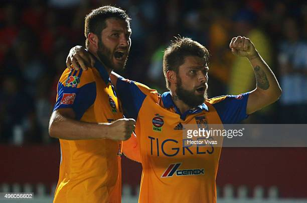 Rafael Sobis of Tigres celebrates with teammate Andre Gignac after scoring the third goal of his team during the 16th round match between Veracruz...