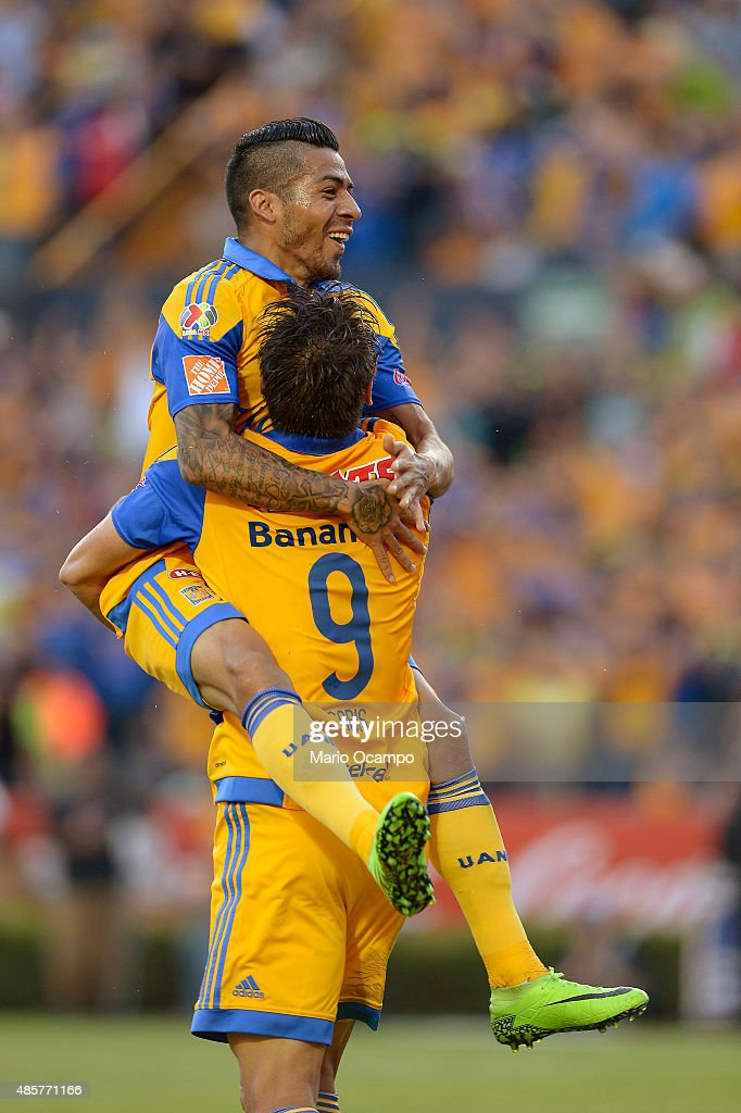 <a gi-track='captionPersonalityLinkClicked' href=/galleries/search?phrase=Rafael+Sobis&family=editorial&specificpeople=682143 ng-click='$event.stopPropagation()'>Rafael Sobis</a> of Tigres celebrates with teammate his <a gi-track='captionPersonalityLinkClicked' href=/galleries/search?phrase=Javier+Aquino&family=editorial&specificpeople=7218711 ng-click='$event.stopPropagation()'>Javier Aquino</a> after scoring his team's fourth goal during a 7th round match between Tigres UANL and Queretaro as part of the Apertura 2015 Liga MX at Universitario Stadium on August 29, 2015 in Monterrey, Mexico.