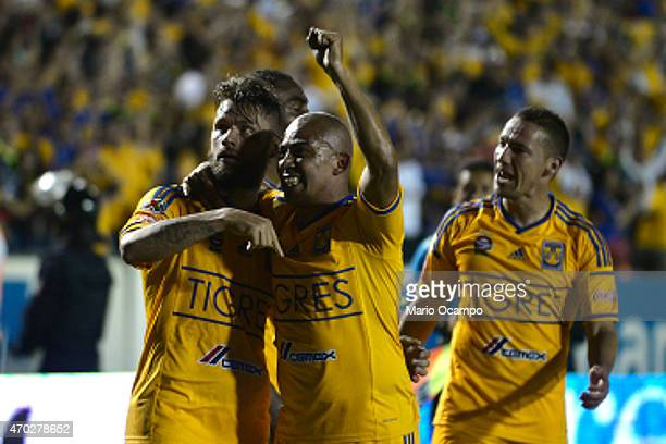Rafael Sobis of Tigres celebrates with teammates after scoring his team's second goal during a match between Tigres UANL and Monterrey as part of...