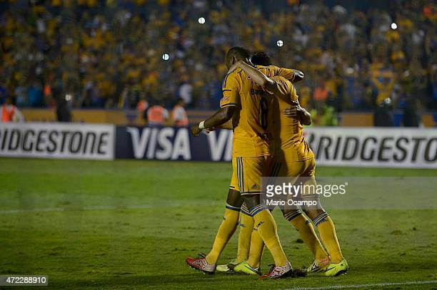 Rafael Sobis of Tigres celebrates with teammates after scoring his team's first goal by a penalty kick during a second leg match between Tigres and...