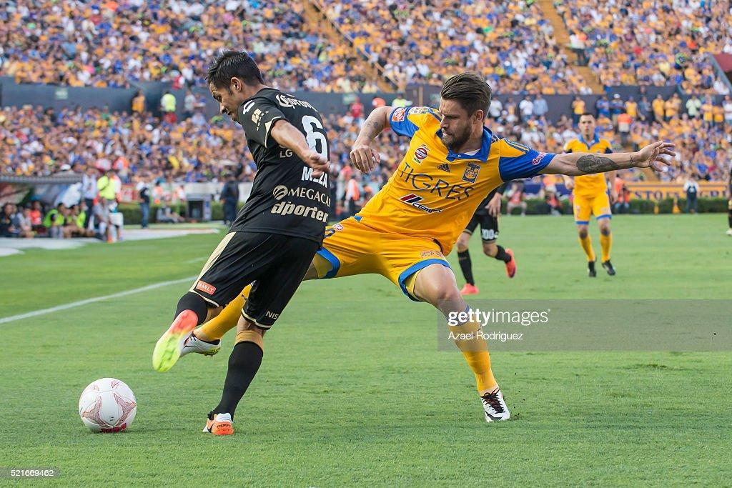 Rafael Sobis of Tigres fights for the ball with Severo Meza of Dorados during the 14th round match between Tigres UANL and Dorados de Sinaloa as part...