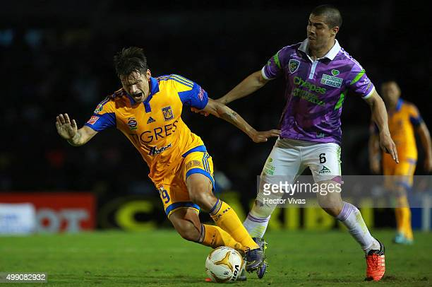 Rafael Sobis of Tigres struggles for the ball with Francisco Silva of Chiapas during the quarterfinals second leg match between Chiapas and Tigres...