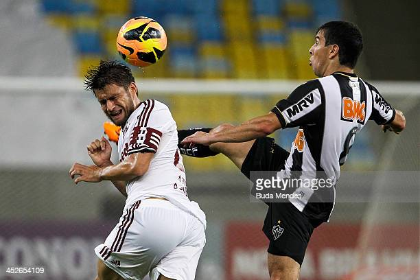 Rafael Sorbis of Fluminense fights for the ball with Leandro Donizette of Atletico Mineiro during the match between Fluminense and Atletico Mineiro...